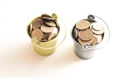 A bucket with coins on a white background is isolate. Business concept Royalty Free Stock Photo