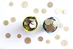 A bucket with coins on a white background is isolate. Business concept Stock Images