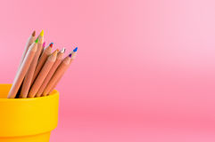 Bucket of color pencil on pink stock image