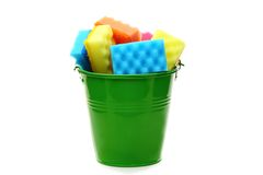 Bucket with colored sponges for cleaning. Stock Image