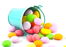 Bucket of colorful candy Stock Images