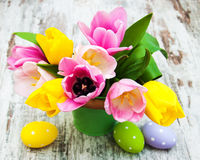 Bucket with colorful tulips and easter eggs Stock Photo