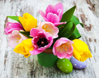 Bucket with colorful tulips and easter eggs Royalty Free Stock Photos