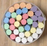 Bucket of Coloured Chalk. Stock Photo