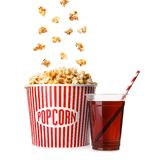 Bucket with delicious popcorn and plastic cup of cola. On white background royalty free stock photos
