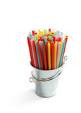 Bucket with drinking straws Stock Image