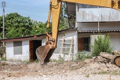 Bucket Excavator destruction in Work outdoor. Bucket Excavator. excavator destruction in Work outdoor  construction,and  dust soil motion : select focus front Stock Photography