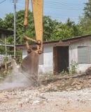 Bucket Excavator. excavator destruction in Work outdoor. Construction,and  dust soil motion : select focus front bucket Excavator Stock Photo