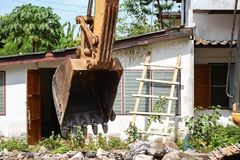 Bucket Excavator. excavator destruction in Work outdoor construction. Select focus front bucket Excavator Royalty Free Stock Images