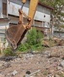 Bucket Excavator. in work excavator destruction construction. Select focus front bucket Excavator Royalty Free Stock Image