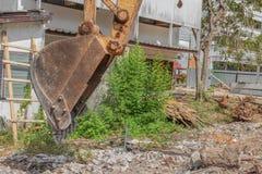 Bucket Excavator. in work excavator destruction construction. Select focus front bucket Excavator Stock Photo