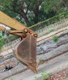 Bucket Excavator. in work excavator destruction construction. Select focus front bucket Excavator Stock Image