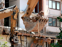 Bucket excavators with construction waste. Works after the demolition of the building Royalty Free Stock Image