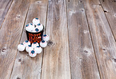Bucket filled with eyeballs for Halloween season on rustic wood Royalty Free Stock Photos