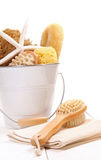 Bucket filled with sponges and scrub brushes Stock Photography