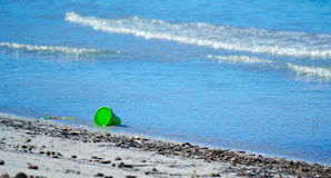 Bucket on the foreshore Royalty Free Stock Photos