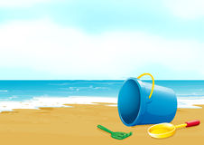 A bucket, fork and shovel at the beach Royalty Free Stock Image