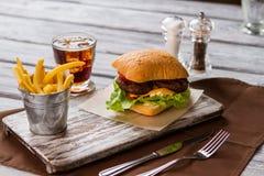 Bucket with fries and hamburger. Stock Photo
