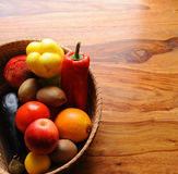 Bucket of fruit and vegetables. On a table royalty free stock photography
