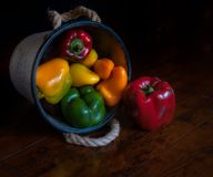 A bucket of bright colourful vegan peppers ready to be eaten stock images