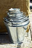A bucket full of buckets, at Feira Franca in Pontevedra. Shoot to a pile of metal buckets royalty free stock photography