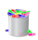 Bucket full of capsules and pills Royalty Free Stock Image