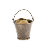 Bucket full of coins Stock Image