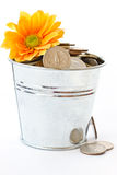 Bucket full of coins Stock Photos