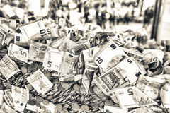 Bucket full of euro banknotes and coins. Financial and economic Royalty Free Stock Photography