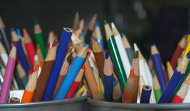 A colorful rainbow of art pencils. A bucket full of multi-colored sharpened drawing pencils Royalty Free Stock Image