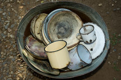 Bucket full of old worn kitchen ware Royalty Free Stock Image