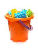 Bucket full of plastic blocks Stock Images
