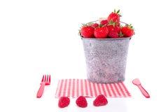 Bucket full of red fruit Stock Photo
