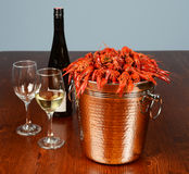 Bucket full of river lobsters with wine Royalty Free Stock Photo