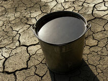 Bucket full of water Stock Photography