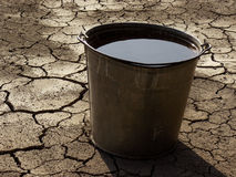 Bucket full of water Stock Images