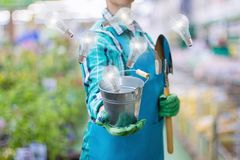 From the bucket the gardener appear the bulb burning . Stock Photo
