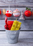 Bucket with gifts on background of Christmas balls. Royalty Free Stock Photography