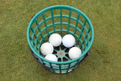 A bucket of golfballs Stock Images
