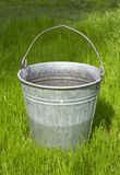 Bucket on the grass Stock Image