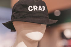 Bucket hat with an inscription `Crap`. Placed on a mannequin`s head Stock Image