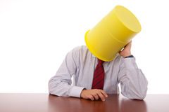 Bucket head businessman. Businessman with a bucket on his head stock images