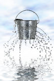 Bucket with holes Stock Image