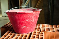 Bucket on hollow bricks Royalty Free Stock Photos