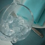 Bucket of ice and tongs on a serving table. With a plate and a napkin Stock Images