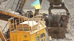 Bucket of industrial excavator, Excavator close up. Extraction of ore in a quarry, a bucket close-up pours out ore in a quarry stock video