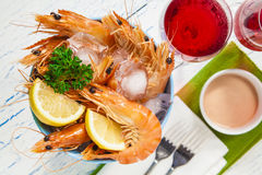 Bucket of king prawns on ice Royalty Free Stock Photography