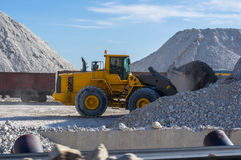 bucket loader loads the clay Stock Photography