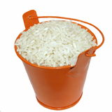 Bucket and Long white rice on white Royalty Free Stock Photography