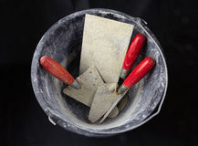 Bucket with masonry tools Royalty Free Stock Photos